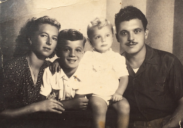 Anna, Guerino (about 6 years old), Ezio (about 1 year old), and Giovanni Raicovich, Italy, circa 1945. This photo was taken about the time the family left Istria for Genoa as refugees.